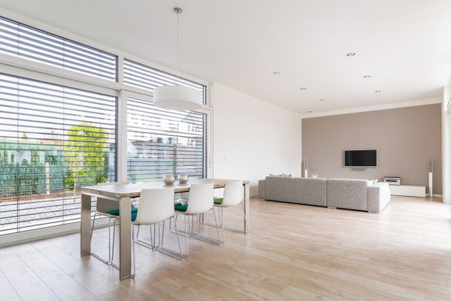 interior of modern minimalist room with large windows